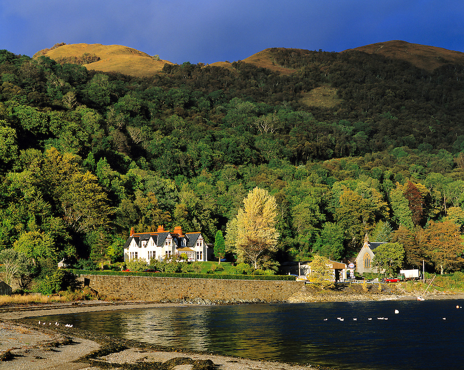 Afternoon sun highlights the buildings at Onich harbor on Loch Linnhe in the NW Highlands of Scotland.