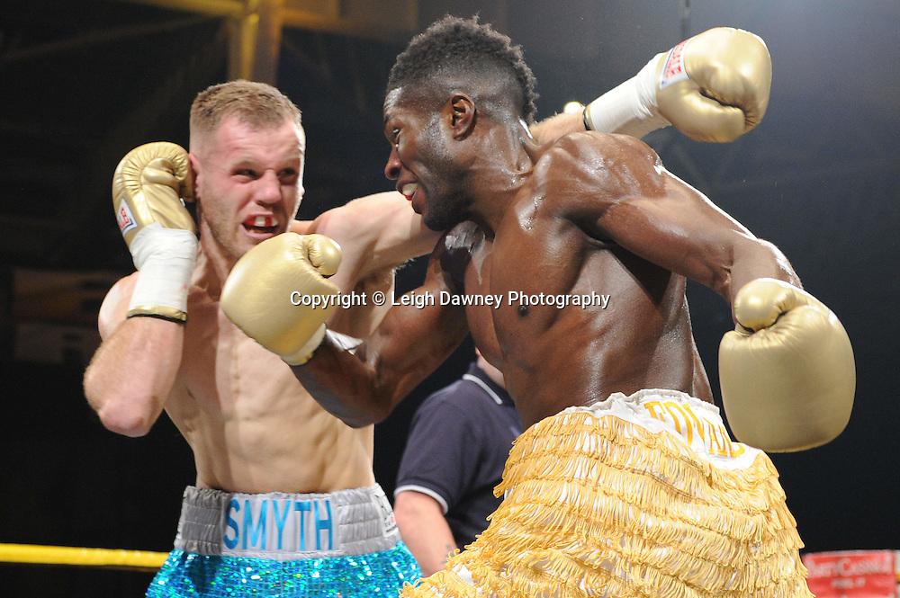 Menay Edwards (yellow shorts) defeats Joe Smyth at Prizefighter The Light Heavyweights II, Olympia, London on 29th January 2011. Photo credit © Leigh Dawney.