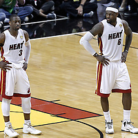 17 June 2012: Miami Heat shooting guard Dwyane Wade (3) and Miami Heat small forward LeBron James (6) rest during the Miami Heat 91-85 victory over the Oklahoma City Thunder, in Game 3 of the 2012 NBA Finals, at the AmericanAirlinesArena, Miami, Florida, USA.