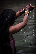 — A devotee offers a handful of the sacred river to the goddess, Shree Swasthani. Striving to attain physical and spiritual purity is the most important goal for Hindus, and water is believed to be the conduit for achieving this. Hindus believe that the rhythm of life is dictated by water, especially the cyclical flow of rivers.