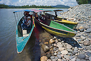 Water taxi canoes pulled up on river bank, Rio Napo, Ecuador