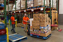 Warehouse Staff Taylor Kline, right and Terrell Allen of Lexington work in the warehouse at God's Pantry poses for portraits, Thursday, April 13, 2017 in Lexington.