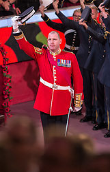© London News Pictures. Pictured: The Garrison Sergeant Major WO1 Vern Stokes, gives a cheer for HM The Queen The Royal Albert Hall, London during the Festival of Remembrance on Saturday 7th November 2015. Max Bryan/LNP