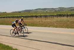 California, San Luis Obispo County: Bicycle riders, couple, on back country road near Edna Valley Vineyard..Photo caluis121-70777..Photo copyright Lee Foster, www.fostertravel.com, 510-549-2202, lee@fostertravel.com