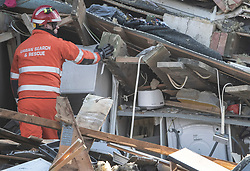 © Licensed to London News Pictures. 27/12/2018. Andover, UK. A member of an Urban Search and Rescue team examines the ruins of the kitchen of a house in Andover, Hampshire where a mans body has been pulled from wreckage, following an explosion in the property. Residents have been evacuated form the area following a blast in the early hours of this morning. Photo credit: Peter Macdiarmid/LNP