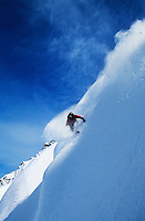 Snowboarder on steep slope