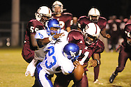 Water Valley's C.J. Jackson (26) forces a fumble as he and Water Valley's Demarrius Coleman (23) rush the quarterback vs. J.Z. George on Friday, September 23, 2011.