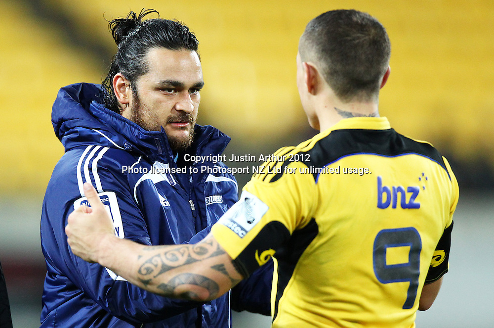 Blues' Piri Weepu  and Hurricanes' TJ Perenara during the 2012 Super Rugby season, Hurricanes v Blues at Westpac Stadium, Wellington, New Zealand on Friday 4 May 2012. Photo: Justin Arthur / photosport.co.nz
