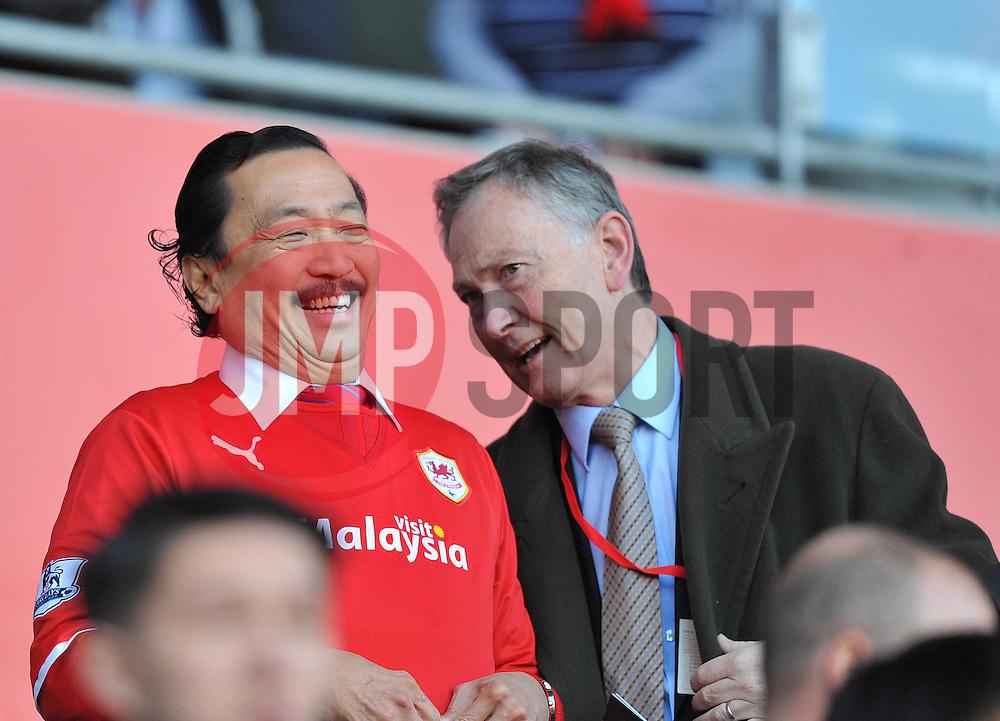 Premier League chief Richard Scudamore makes Cardiff City owner Vincent Laugh. - Photo mandatory by-line: Alex James/JMP - Tel: Mobile: 07966 386802 30/11/2013 - SPORT - Football - Cardiff - Cardiff City Stadium - Cardiff City v Arsenal - Barclays Premier League
