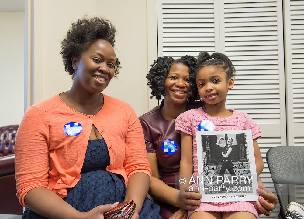 Garden City, New York, USA. 17th April 2016. L-R, TORESHA PETERSON, JOANNE VANTERPOOL and, her 7-year-old daughter JORDAN VANTERPOOL, all from Hempstead, are campaign volunteers for Democratic presidential primary candidate Hillary Clinton, and are attending the Canvass Kickoff at the Nassau County Democratic Office, part of the GOTV Get Out The Vote for Hillary four day weekend event.