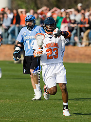 Virginia midfielder Will Barrow (23) in action against JHU.  The #2 ranked Virginia Cavaliers defeated the #6 ranked Johns Hopkins Blue Jays 13-12 in overtime at the University of Virginia's Klockner Stadium in Charlottesville, VA on March 22, 2008.  The loss, in front of a record UVA crowd of 7,500, was the third consecutive overtime defeat for Hopkins, the defending national champions.