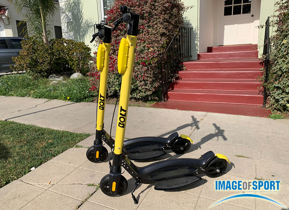 Detailed view of Bolt electric scooter, Monday, June 24, 2019, in Los Angeles. The yellow scooter features footholds located on either side of the riding board, which the company Bolt Mobility says allows for greater balance. Bolt Mobility, was founded in March 2018 by entrepreneurs Kamyar Kaviani and Sarah Haynes, with brand ambassador Usain Bolt. (Kirby Lee via AP)