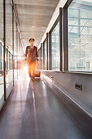 Portrait of mature pilot walking with his suitcase in airport