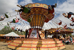 Children spinning around on a carousel at the WOMAD (World of Music; Arts and Dance) Festival in reading; 2005,