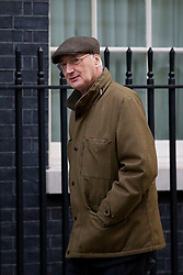 © Licensed to London News Pictures. 26/11/2013. London, UK. The Chief Whip, Sir George Young, arrives for a meeting of British Prime Minister David Cameron's Cabinet on Downing Street in London today (26/11/2013). Photo credit: Matt Cetti-Roberts/LNP