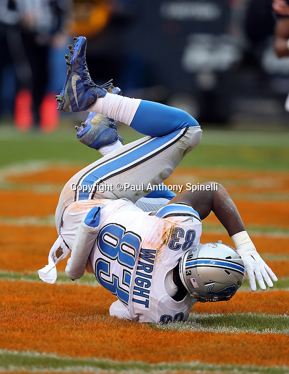 Detroit Lions tight end Timothy Wright (83) is upended as he catches a 9 yard touchdown pass for a 7-0 first quarter Lions lead during the NFL week 17 regular season football game against the Chicago Bears on Sunday, Jan. 3, 2016 in Chicago. The Lions won the game 24-20. (©Paul Anthony Spinelli)