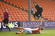 Blackpool's Jim McAlister (4) getsthe tackle on Barnsley's Josh Scowen (6) during the The FA Cup 3rd round match between Blackpool and Barnsley at Bloomfield Road, Blackpool, England on 7 January 2017. Photo by Craig Galloway.