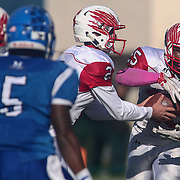 Smyrna running back William Knight (25) receives the hand off from Nolan Henderson (2) during the DIAA division one Football Championship game between Top-seeded Middletown (11-0) and second-seeded Smyrna (11-0) Saturday, Dec. 03, 2016 at Delaware Stadium in Newark.