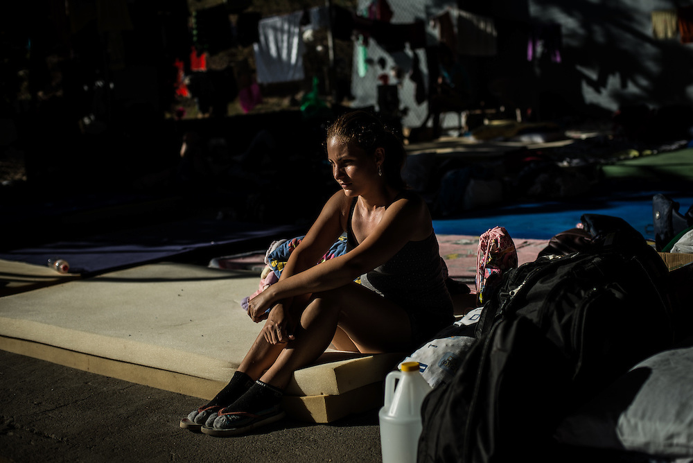 "LA CRUZ, COSTA RICA - JANUARY 5, 2016: In Gretchen López's slumber, during whatever winks of sleep she could get sleeping in a crowded open air shelter, she dreamed she was sending money to her mother in Havana to renovate her crumbling house and buy delicious food. ""But I woke up and I was here,"" she said, looking around a fire station in rural Costa Rica, where she sleeps on a foam mattress beside hundreds of other Cubans who got stuck here while trying to make it by land to the United States.  After two months stranded in Costa Rica, Ms. López's fantasy is inching closer to fruition. Thanks to an unprecedented accord hatched by four governments, nearly 8,000 Cubans who have languished in shelters here because of a political impasse with Nicaragua will soon be heading to the United States.  PHOTO: Meridith Kohut for The New York Times"