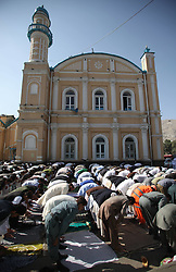 Image ©Licensed to i-Images Picture Agency. 28/07/2014. Kabul, Afghanistan. <br /> 61981780<br /> Afghan men attend Eid-al-Fitr prayers at a mosque in Kabul, Afghanistan, on July 28, 2014. Muslims around the world celebrate Eid al-Fitr, marking the end of the fasting month of Ramadan. Picture by  imago / i-Images<br /> UK ONLY