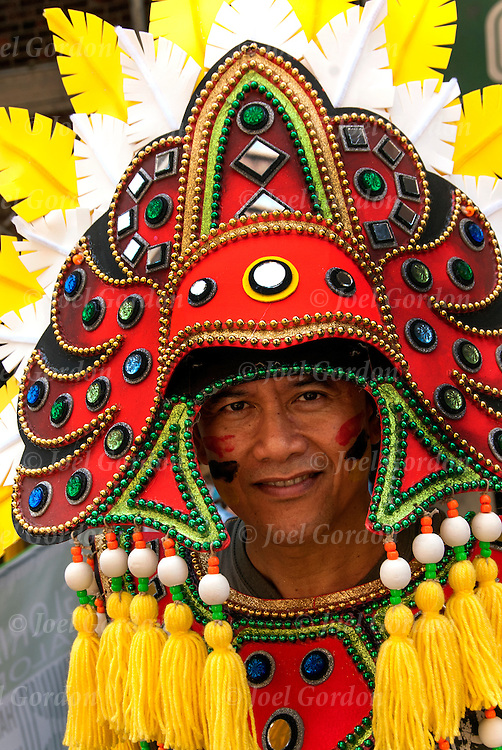 Ethnic Pride for Filipinos in the Philippine Day Day Parade. Wearing Carnival regalia and mask.