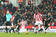 Raheem Sterling takes advantage of indecision at a drop ball during the Premier League match between Stoke City and Manchester City at the Bet365 Stadium, Stoke-on-Trent, England on 12 March 2018. Picture by Graham Holt.