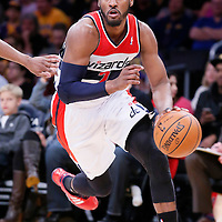 21 March 2014: Washington Wizards guard John Wall (2) dribbles during the Washington Wizards 117-107 victory over the Los Angeles Lakers at the Staples Center, Los Angeles, California, USA.
