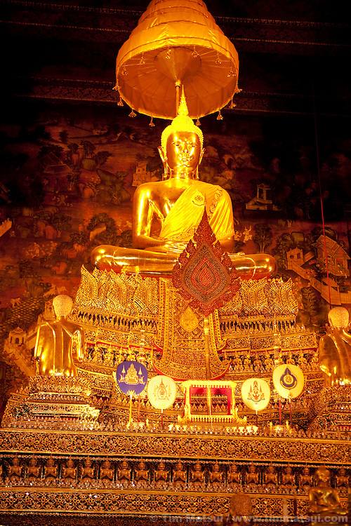 A gold gilded bronze Buddha at Wat Suthat in the heart of Bangkok, Thailand.