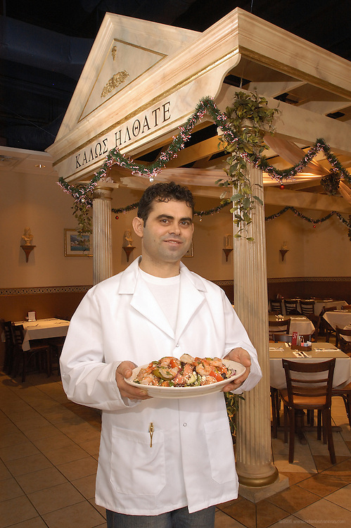 The Greek Corner, Colombus, Ohio: Owner Orian Trifoni, holds the special: a Winter Salad of tomato, cucumber, green peppers, red onions, olives and feta cheese with shrimp.