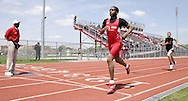 An official (left) watches Trotwood win and Stivers place second in the Boys 800 Meter Run during the Buff Taylor Memorial Track & Field Invitational at the Good Samaritan Sports Plex at Trotwood Madison High School, Saturday, May 10, 2008.