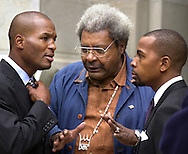 Boxer Bernard Hopkins (L), and boxing promoter Don King (C), along with an unidentified man (R) speak outside City Hall, Wednesday, October 9, 2002, in Philadelphia. (Photo by William Thomas Cain/photodx.com)