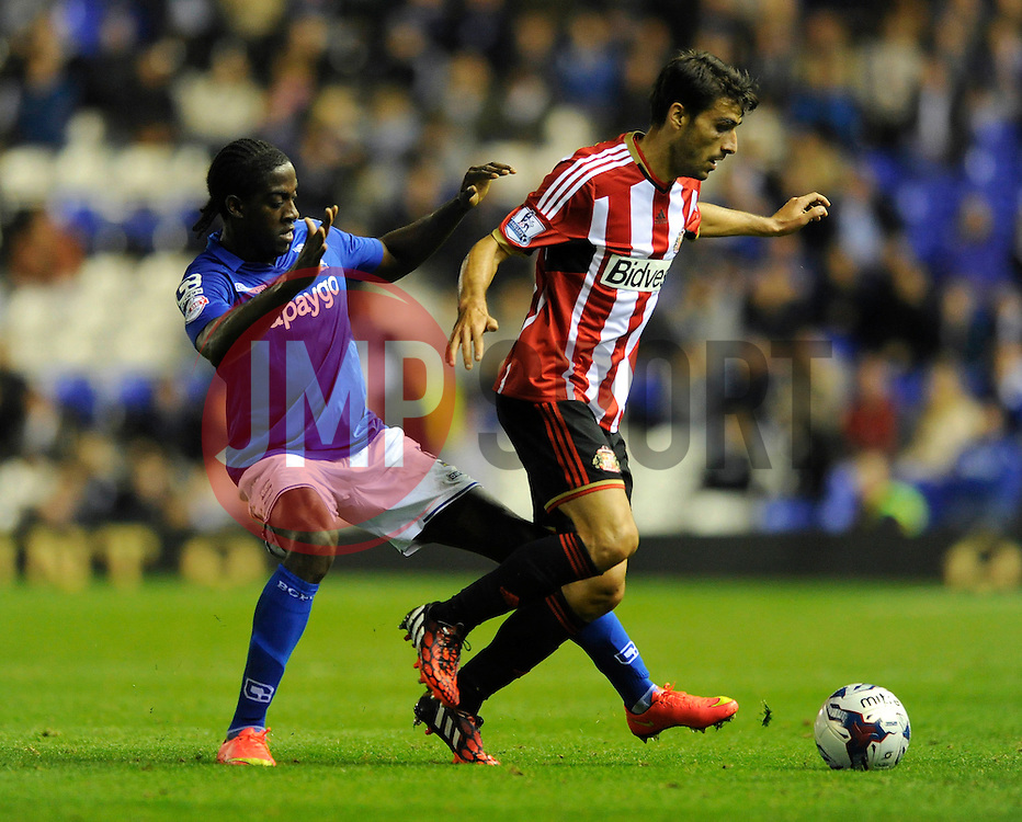 Birmingham City's Clayton Donaldson challenges for the ball with  Sunderland's Jordi Gomez - Photo mandatory by-line: Dougie Allward/JMP - Mobile: 07966 386802 27/08/2014 - SPORT - FOOTBALL - Birmingham - St Andrews Stadium - Birmingham City v Sunderland - Capital One Cup
