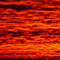 Orange colored sky and clouds at sunset