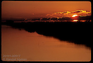 Sun sets over one of two main irrigation canals watering Granja Bretanha's 7400 ac. of rice; RS. Brazil