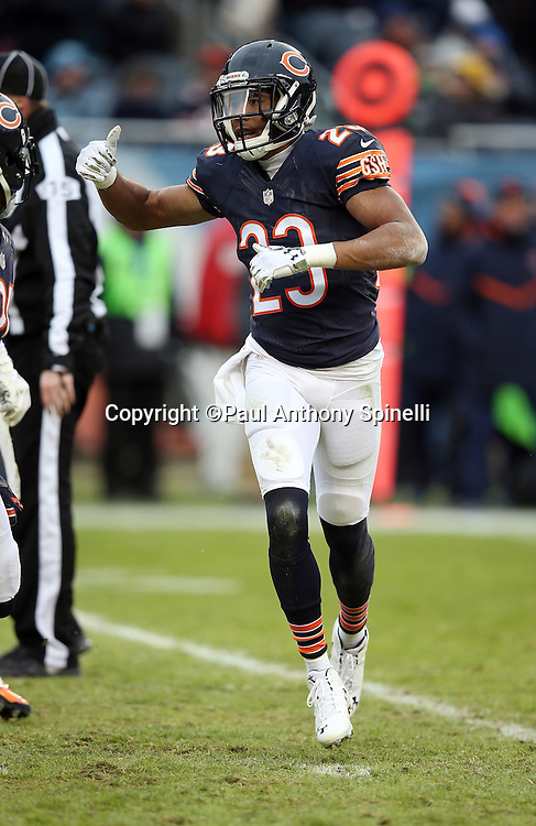 Chicago Bears cornerback Kyle Fuller (23) motions with his hand as he runs cross field during the NFL week 17 regular season football game against the Detroit Lions on Sunday, Jan. 3, 2016 in Chicago. The Lions won the game 24-20. (©Paul Anthony Spinelli)