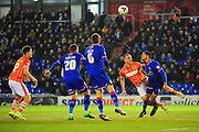 Timothée Dieng of Oldham Athletic heads clear from Tom Aldred of Blackpool FC during the Sky Bet League 1 match between Oldham Athletic and Blackpool at SportsDirect.Com Park, Oldham, England on 15 March 2016. Photo by Mike Sheridan.