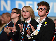 © Licensed to London News Pictures. 09/10/2012. Birmingham, UK Delegates watche as Home Secretary Theresa may makes her keynote conference speech at The Conservative Party Conference at the ICC today 9th October 2012. Photo credit : Stephen Simpson/LNP