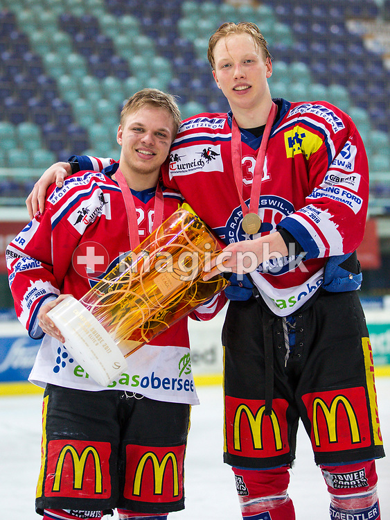 (L-R) Rapperswil-Jona Lakers forward Noah Allabauer and Ryhor Ustsimenka pose for a photo with their gold medals and the Swiss Champion trophy after winning the fifth Elite B Playoff Final ice hockey game between Rapperswil-Jona Lakers and ZSC Lions held at the SGKB Arena in Rapperswil, Switzerland, Sunday, Mar. 19, 2017. (Photo by Patrick B. Kraemer / MAGICPBK)