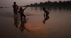 September 23, 2016 - Lahore, Punjab, Pakistan - Pakistani gypsy children busy fishing in River Ravi during an attractive and beautiful sunset in Lahore. (Credit Image: © Rana Sajid Hussain/Pacific Press via ZUMA Wire)