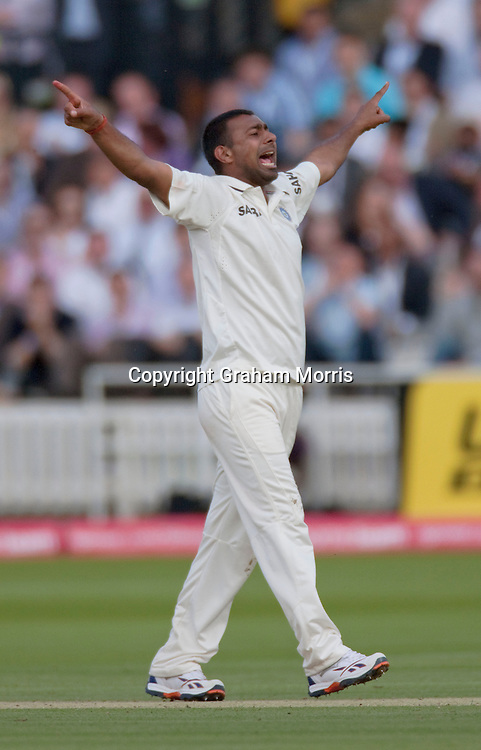 Praveen Kumar celebrates the first ball lbw of Stuart Broad during the first npower Test Match between England and India at Lord's Cricket Ground, London.  Photo: Graham Morris (Tel: +44(0)20 8969 4192 Email: sales@cricketpix.com) 22/07/11