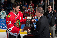 KELOWNA, CANADA - APRIL 25: Ron Robison, Commissioner of the Western Hockey League, hands the Western Conference trophy to Taylor Leier #20 of the Portland Winterhawks on April 25, 2014 during Game 5 of the third round of WHL Playoffs at Prospera Place in Kelowna, British Columbia, Canada. The Portland Winterhawks won 7 - 3 and took the Western Conference Championship for the fourth year in a row earning them a place in the WHL final.  (Photo by Marissa Baecker/Getty Images)  *** Local Caption *** Ron Robison; Taylor Leier;