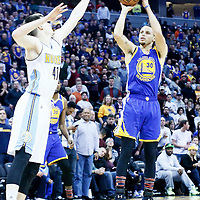 13 February 2017: Golden State Warriors guard Stephen Curry (30) takes a  jump shot over Denver Nuggets forward Juancho Hernangomez (41) during the Denver Nuggets 132-110 victory over the Golden State Warriors, at the Pepsi Center, Denver, Colorado, USA.
