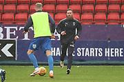 AFC Wimbledon midfielder Scott Wagstaff (7) and AFC Wimbledon midfielder Mitchell (Mitch) Pinnock (11) warming up during the EFL Sky Bet League 1 match between Charlton Athletic and AFC Wimbledon at The Valley, London, England on 15 December 2018.