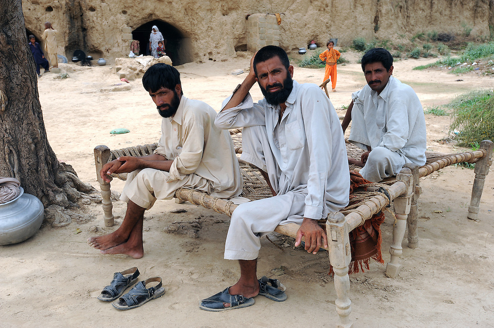 11/8/2009 Sarwar, Lashker and Behram from the Swat valley who were forced to flee their homes folowing intense fighting between the Taliban and Pakistani Government forces. They walked for ten days and reached Haripur where they are now living in caves. PHOTO KIM HAUGHTON