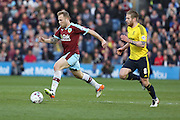 Scott Arfield of Burnley carries the ball followed by Adam Clayton of Middlesbrough during the Sky Bet Championship match between Burnley and Middlesbrough at Turf Moor, Burnley, England on 19 April 2016. Photo by Simon Brady.