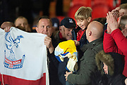 Crystal Palace defender Joel Ward (2) gives his shirt to a young Crystal Palace fan at full time during the The FA Cup 5th round match between Doncaster Rovers and Crystal Palace at the Keepmoat Stadium, Doncaster, England on 17 February 2019.