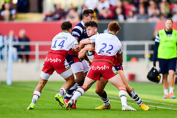 Piers O'Conor of Bristol Bears is tackled by Tom Collins of Northampton Saints and Andrew Kellaway of Northampton Saints  - Mandatory by-line: Ryan Hiscott/JMP - 29/09/2018 - RUGBY - Ashton Gate Stadium - Bristol, England - Bristol Bears v Northampton Saints - Gallagher Premiership Rugby