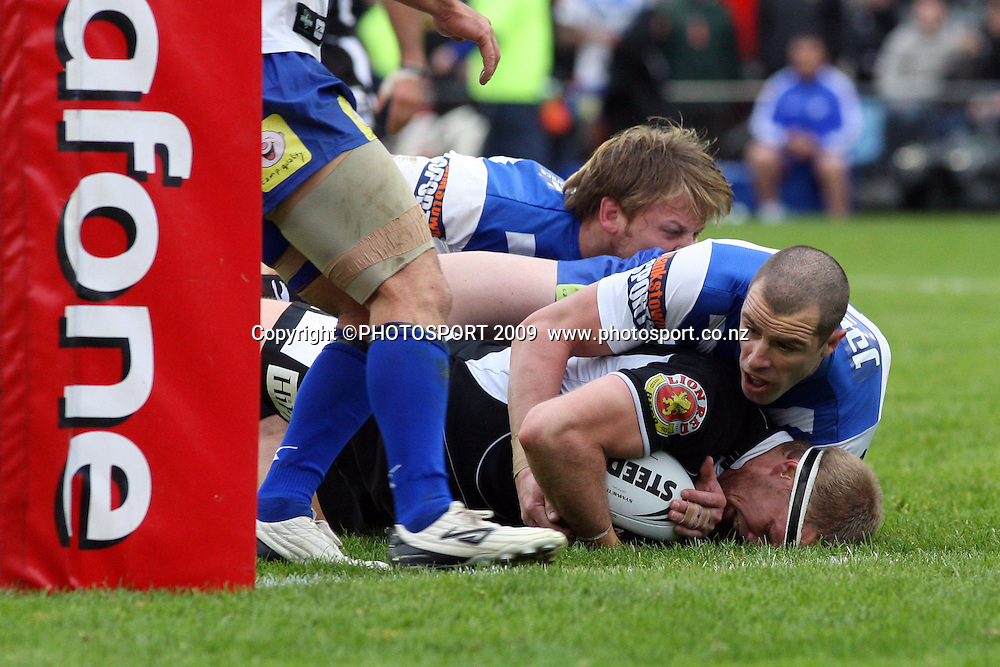 Michael Luck falls and is tackled just short of the try line.<br />NRL. Vodafone Warriors v Canterbury Bulldogs, Mt Smart Stadium, Auckland, New Zealand. Sunday 12 July 2009. Photo: Andrew Cornaga/PHOTOSPORT<br /><br />Editorial Use Only