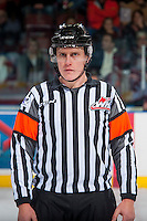 KELOWNA, CANADA - JANUARY 4: Referee Ward Pateman stands on the ice between the Kelowna Rockets and theSpokane Chiefs on January 4, 2017 at Prospera Place in Kelowna, British Columbia, Canada.  (Photo by Marissa Baecker/Shoot the Breeze)  *** Local Caption ***