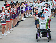 The Wounded Warrior Amputee Football Team is cheered on by Waltrip High School cheerleaders before a game against NFL Alumni, at Delmar Stadium, February 1, 2017.